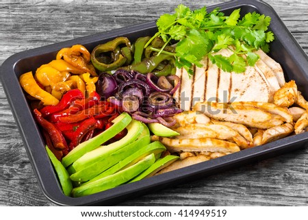 Delicious Chicken Fajita Platter with Avocado, Bell Pepper, Red Onion and Cilantro, close up - stock photo