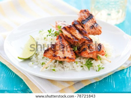Delicious chicken masala skewers with rice - stock photo