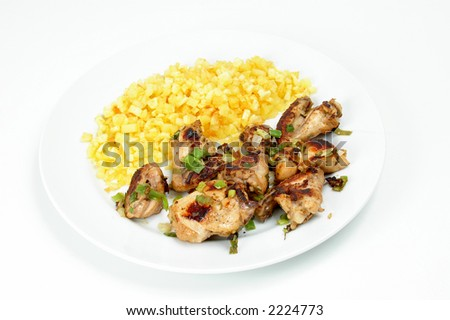 Delicious chicken pieces with green onion sprinkled and french fries