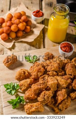 Delicious chicken popcorn, with hot tomato souce and potato croquettes - stock photo