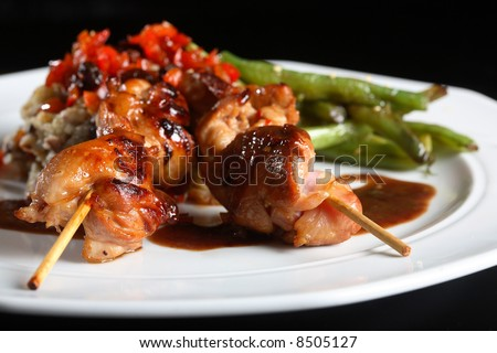 Delicious chicken satay on skewers - stock photo