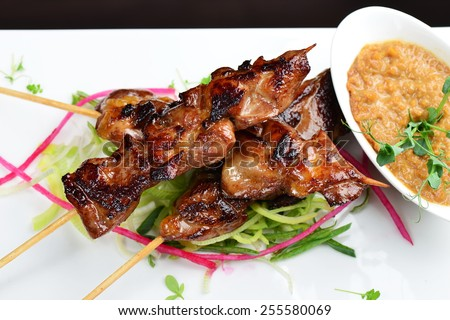 Delicious chicken satay on skewers. Yakitori - stock photo