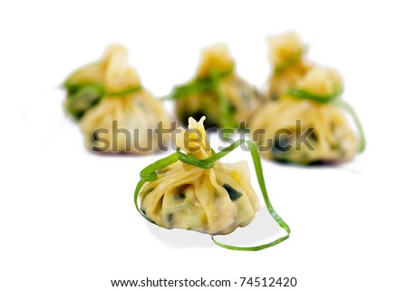 Delicious Chinese dumplings isolated on white - stock photo