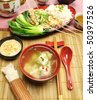 Delicious Chinese short soup with chicken skewers and vegetables. - stock photo