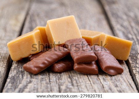 Delicious chocolate and caramel candies on a white background.