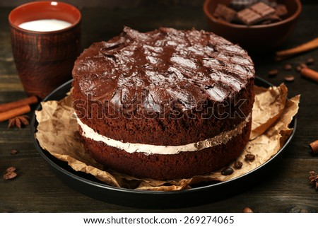 Delicious chocolate cake on table close-up - stock photo