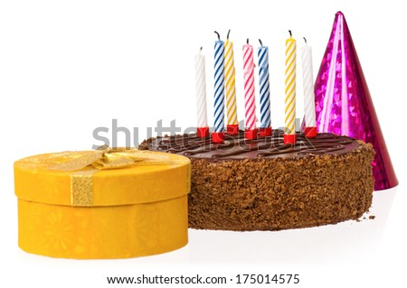Delicious chocolate cake with candles and gift box, isolated on white background - stock photo