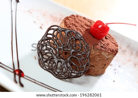 delicious chocolate cake with cherry on top - stock photo