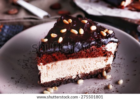 Delicious chocolate cake with icing in plate on table, closeup - stock photo
