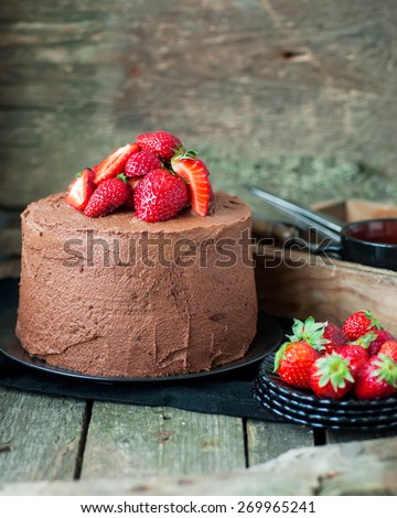 Delicious chocolate cake with strawberries, selective focus - stock photo