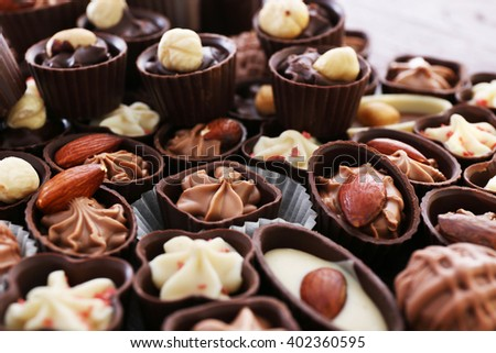 Delicious chocolate candies background, close up - stock photo