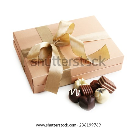 Delicious chocolate candies in gift box isolated on white - stock photo