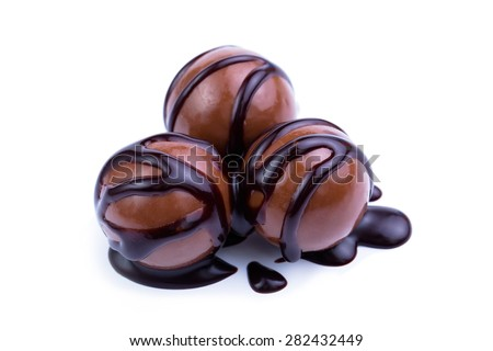 Delicious chocolate candies on a white background. - stock photo