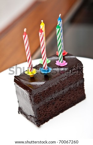 Delicious chocolate fudge cake with 5 colorful candles - stock photo