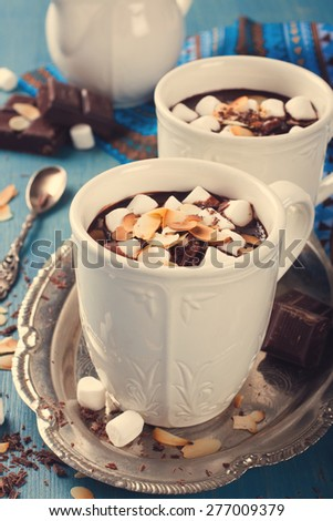 Delicious chocolate milk made from almond milk with marshmallow and almond chips. Retro style toned.  - stock photo