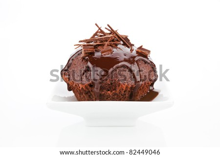 Delicious chocolate muffin with chocolate garnish isolated on white background.