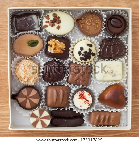 Delicious chocolate pralines in a box. - stock photo