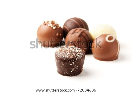 Delicious chocolate pralines isolated on white background - stock photo
