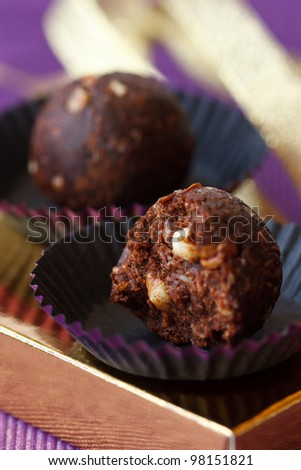 Delicious chocolate truffle with nuts close up.