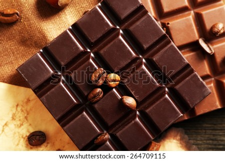 Delicious chocolates with nuts spices on table, closeup - stock photo