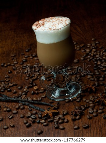 Delicious christmas coffee with aromatic spices - stock photo