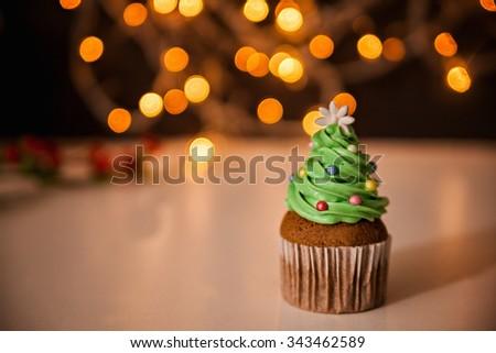 Delicious Christmas Dessert. Christmas Tree Cupcake. Copy Space - stock photo