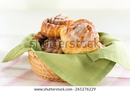 Delicious cinnamon buns with glaze  icing - stock photo