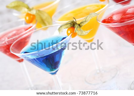 Delicious coctails garnished with fruits - stock photo