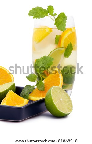 Delicious cold cocktail, mixed with ice, lime and mint. - stock photo