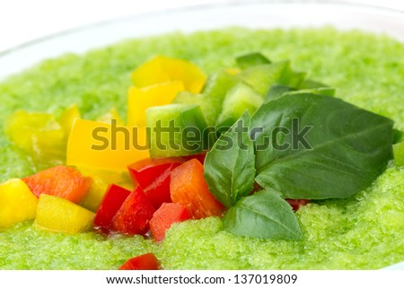Delicious cold green gazpacho soup with basil leaves closeup - stock photo