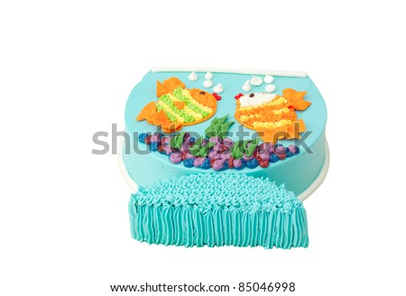 Delicious colorful birthday cake in shape of fish - stock photo