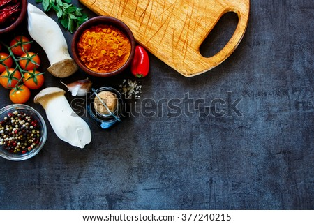 Delicious colorful farm vegetables and ingredients for healthy cooking on rustic background, border, top view. Vegetarian or diet food concept.