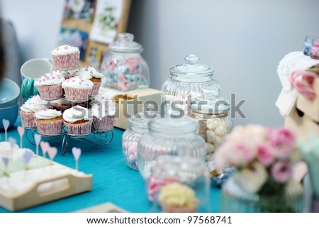 Delicious colorful wedding cupcakes with hearts icing - stock photo