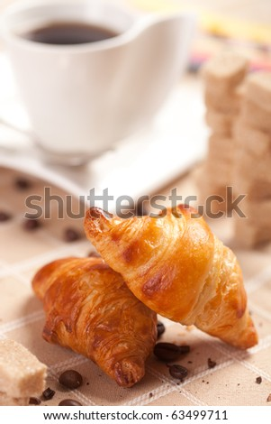 Delicious continental breakfast of coffee and croissant - stock photo