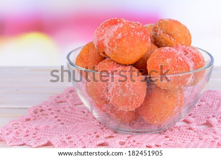 Delicious cookies peaches on table on light background - stock photo
