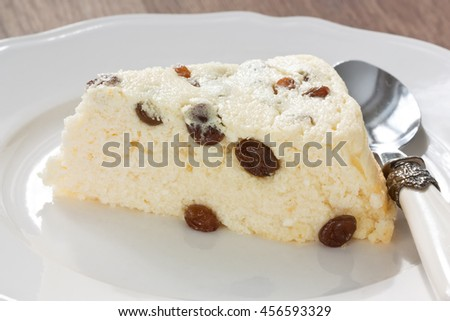Delicious cottage cheese souffle with raisins on white plate/Cottage cheese souffle - stock photo