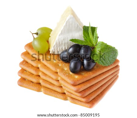 Delicious crackers with camembert and grapes.
