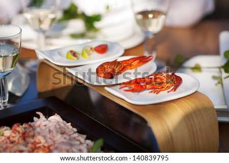 delicious crayfish on dining table with white wine - stock photo