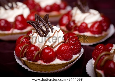 Delicious cream cake with raspberries and chocolate and whipped cream - stock photo