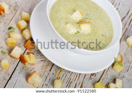Delicious creamy vegetable soup with spinach and croutons