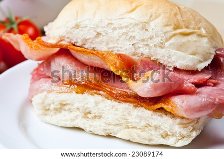 Delicious crispy bacon sandwich on a plate - stock photo