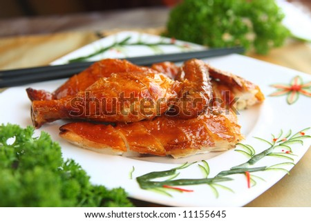 Delicious crispy chicken oriental style. $8.95 in Chinatown. - stock photo