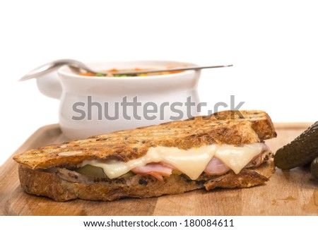 Delicious Cuban panini made with ham, pork and swiss cheese served with a vegetable soup, pickles - stock photo