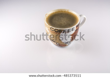 delicious cup of black coffee on a light background