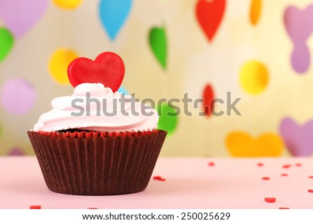 Delicious cupcake for Valentine Day on bright background - stock photo