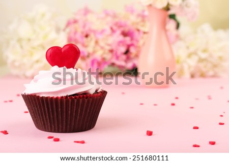 Delicious cupcake for Valentine Day on pink background - stock photo