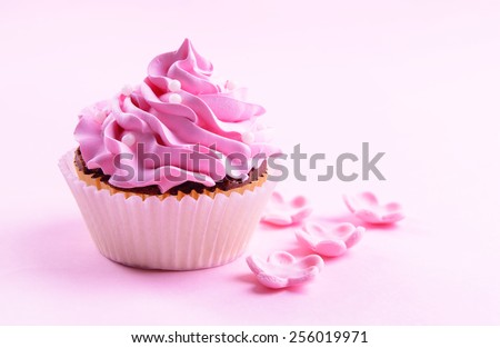 Delicious cupcake on pink background - stock photo