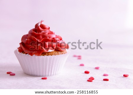 Delicious cupcake on table close-up - stock photo