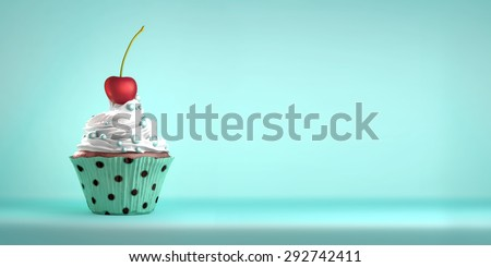 Delicious cupcake topped with a cherry with whipped cream and sweeties. The cherry on the cake metaphor. Copy space. - stock photo
