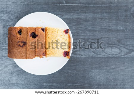 delicious cupcake with a cherry on a white saucer - stock photo